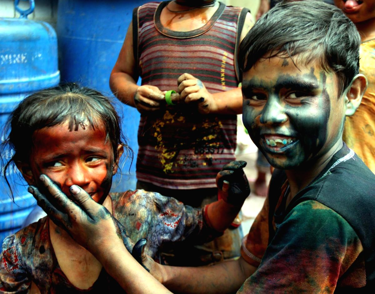 Karachi, Pakistan - Pakistani Hindu children with colored powder on their faces celebrate the Holi Festival, also known as the Festival of Colours.