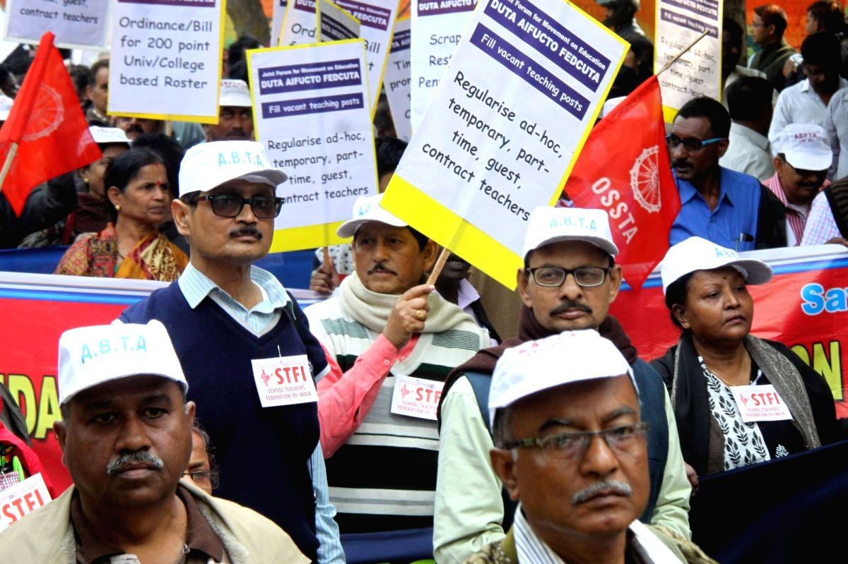 Members of Delhi University Teachers' Association (DUTA) stage a demonstration to press for their demands in New Delhi.