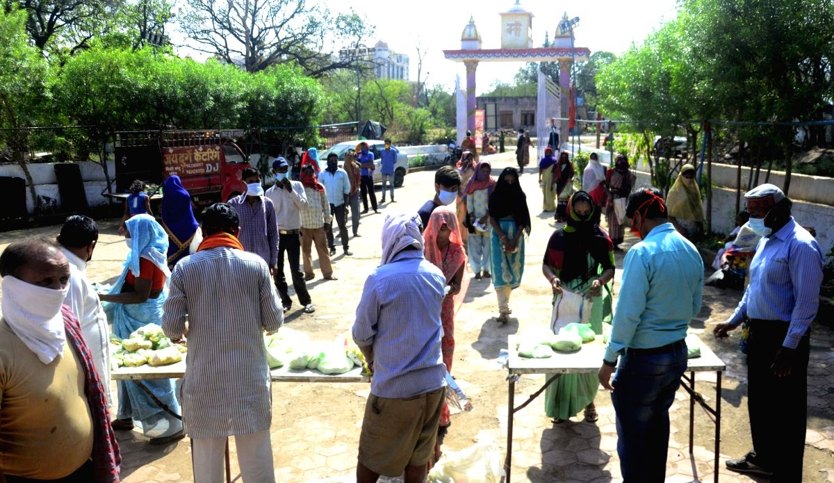 Members of Sanskriti Bachao Manch distribute foodgrains among the poor and needy people in Bhopal