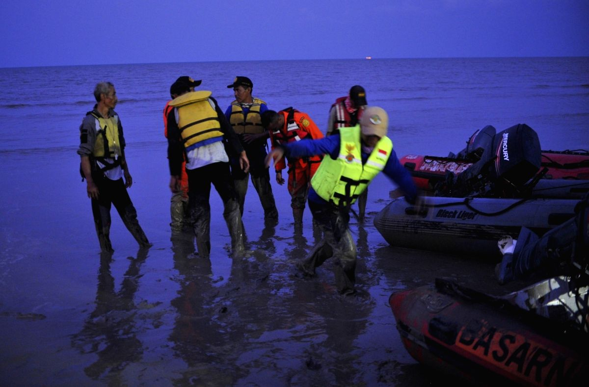 Members of Search and Rescue team gather after searching at Tanjung Pakis Beach in Karawang, West Java Province, Indonesia