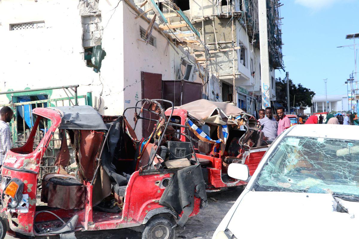 MOGADISHU, June 15, 2019 (Xinhua) -- Photo taken on June 15, 2019 shows the scene of a car bomb blast in Mogadishu, capital of Somalia. At least 10 people were killed and 26 others injured in two car bomb blasts in Mogadishu, police said on Saturday.