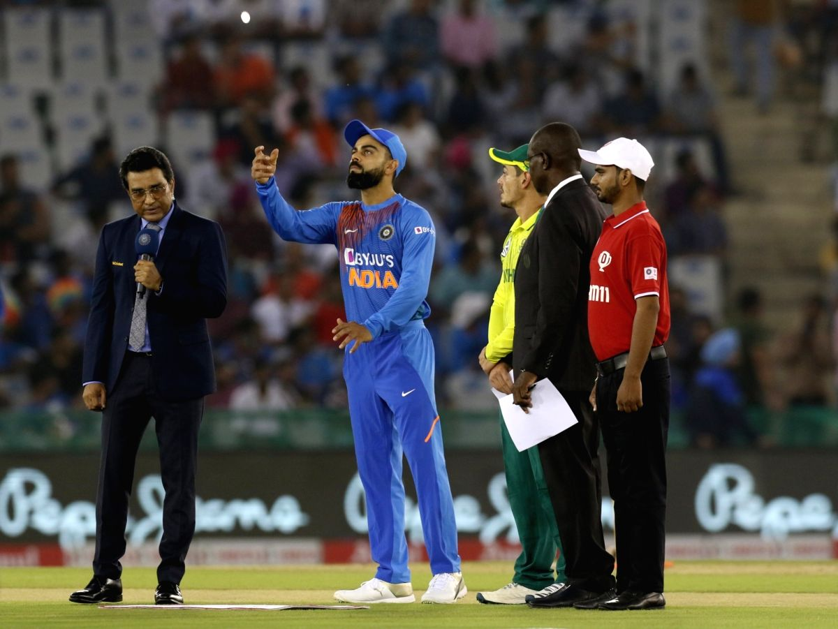 Mohali: Indian skipper Virat Kohli and South African skipper Quinton de Kock during the toss ahead of the 2nd T20I match between India and South Africa at Punjab Cricket Association IS Bindra Stadium in Mohali on Sep 18, 2019. (Photo: Surjeet Yadav/I