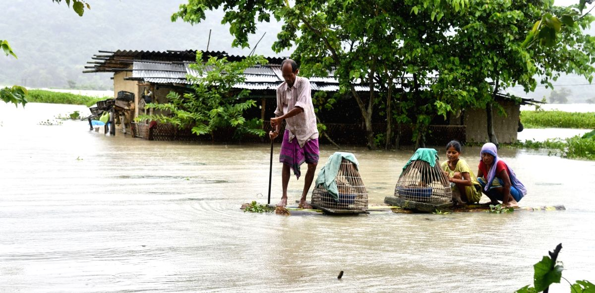 Morigaon: People move to higher places in flood hit Morigaon, Assam.
