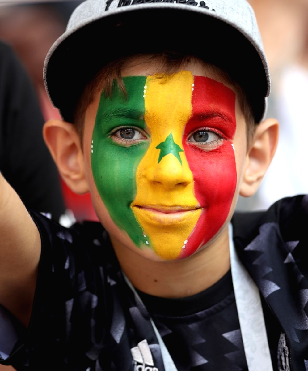 Little Senegal supporter sporting vibrant colors in the match between Poland  and Senegal