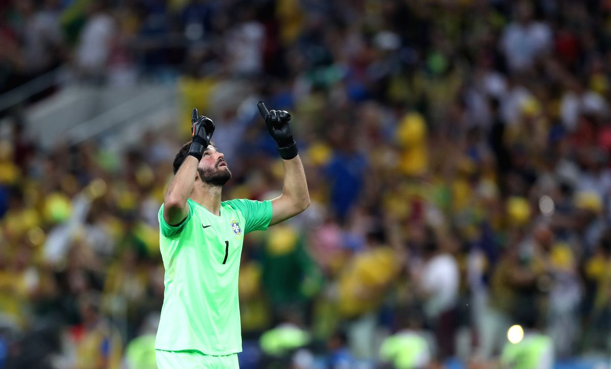 Brazil's goalkeper Alisson celebrates after a victorious match