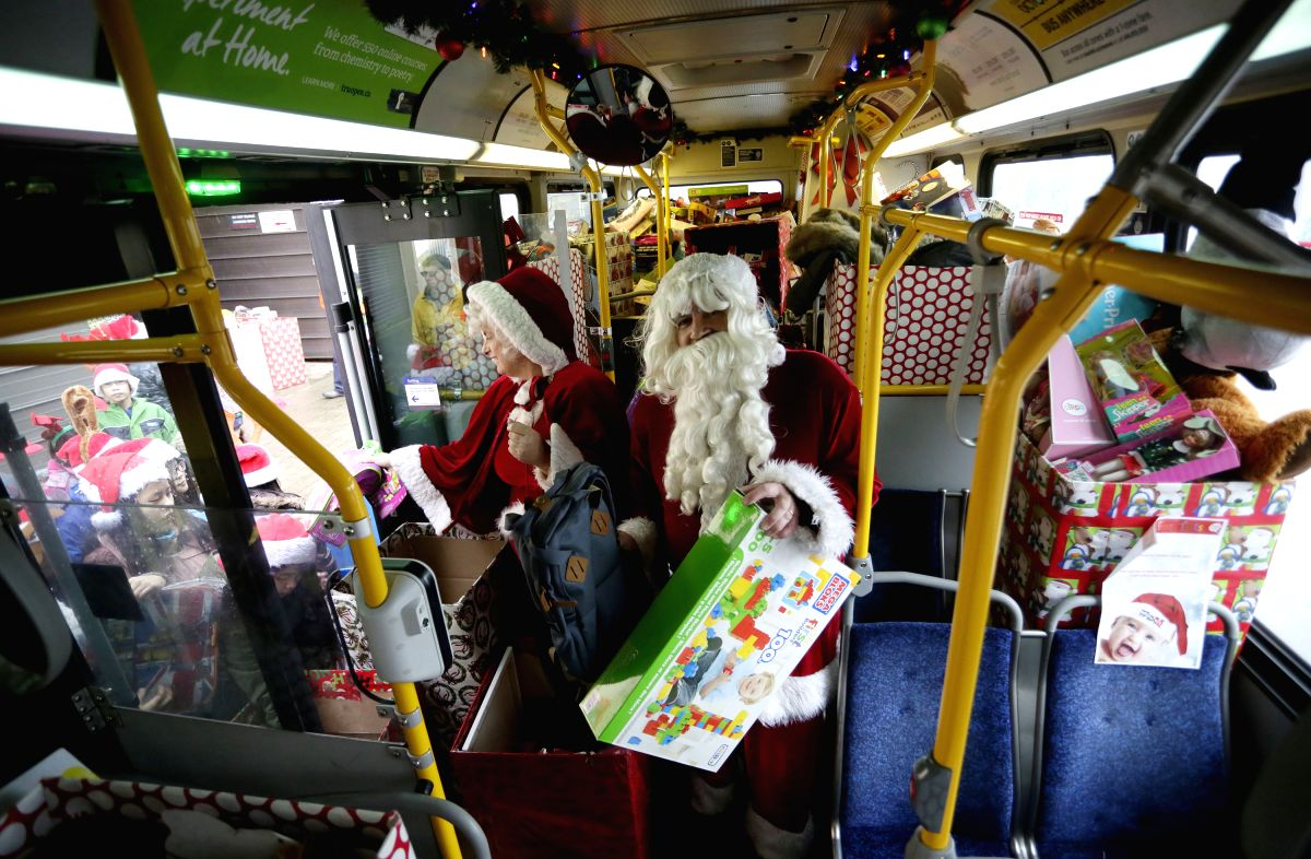 Santa on the Gift Bus !!