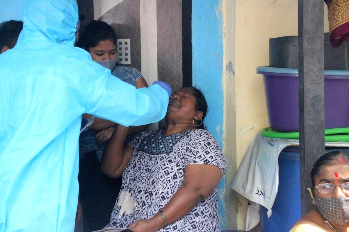 Mumbai: A health worker swab test of a resident for COVID-19 following rise in coronavirus cases at Dharavi in Mumbai, Maharashtra on Tuesday 23rd February, 2021. (Photo: Sandeep Mahankal/IANS) .