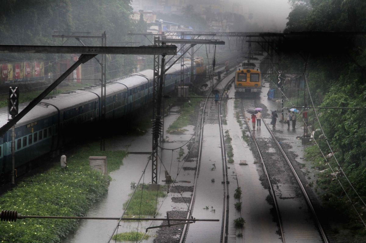 Mumbai: A train halts at Sion Station after heavy rains leave railway tracks water-logged, in Mumbai on July 2, 2019.