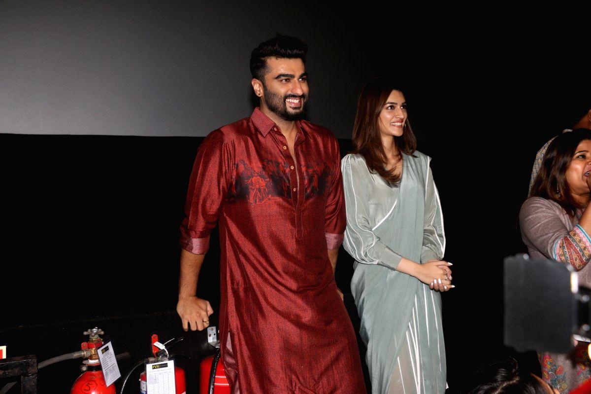 """Mumbai: Actors Arjun Kapoor Kriti Sanon and at the screening of film """"Panipat"""" in Mumbai on Dec 6, 2019."""
