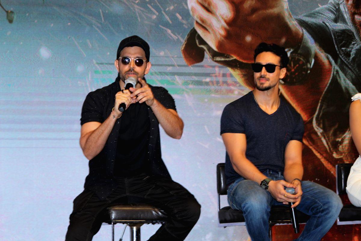 "Actors Tiger Shroff, Hrithik Roshan and Vaani Kapoor during a press conference regarding film ""War"""