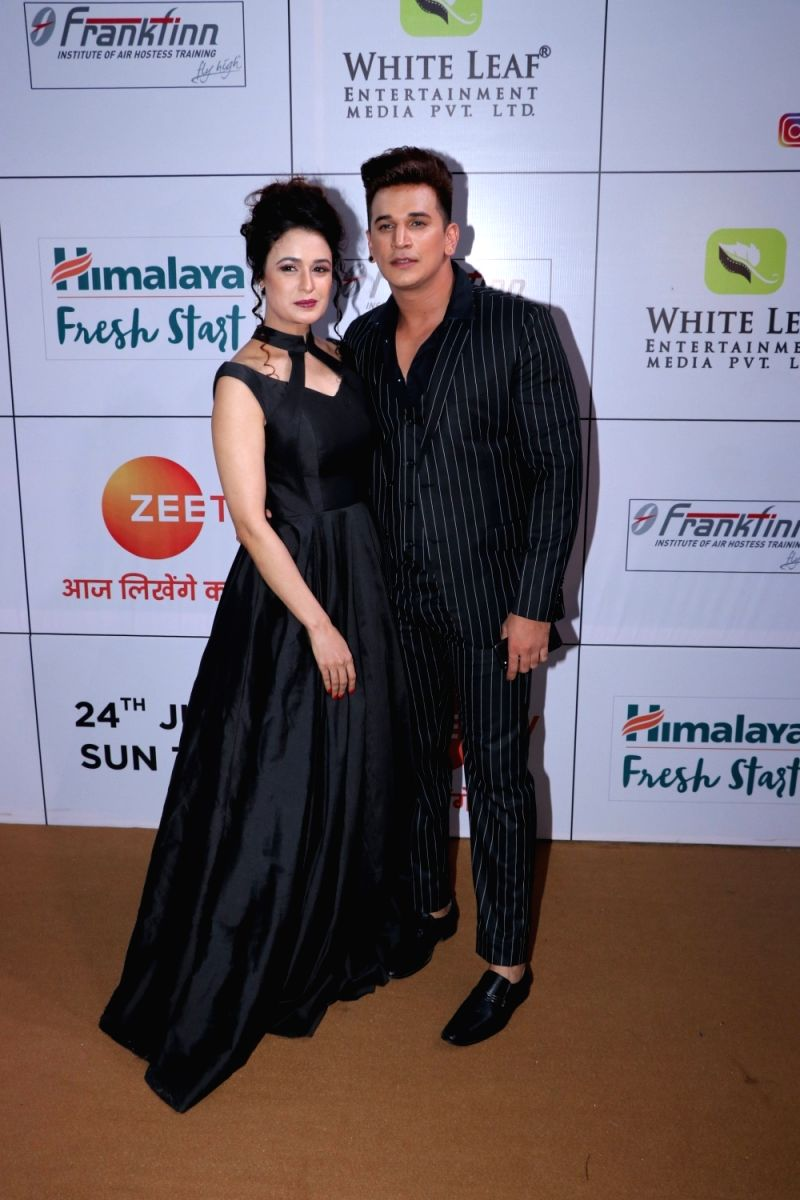 Lovebirds, Yuvika Chaudhary and Prince Narula strike a pose. Both of them look ravishing in their black ensemble