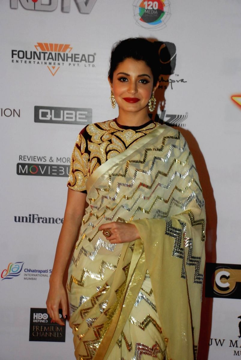 Anushka Sharma in a golden saree