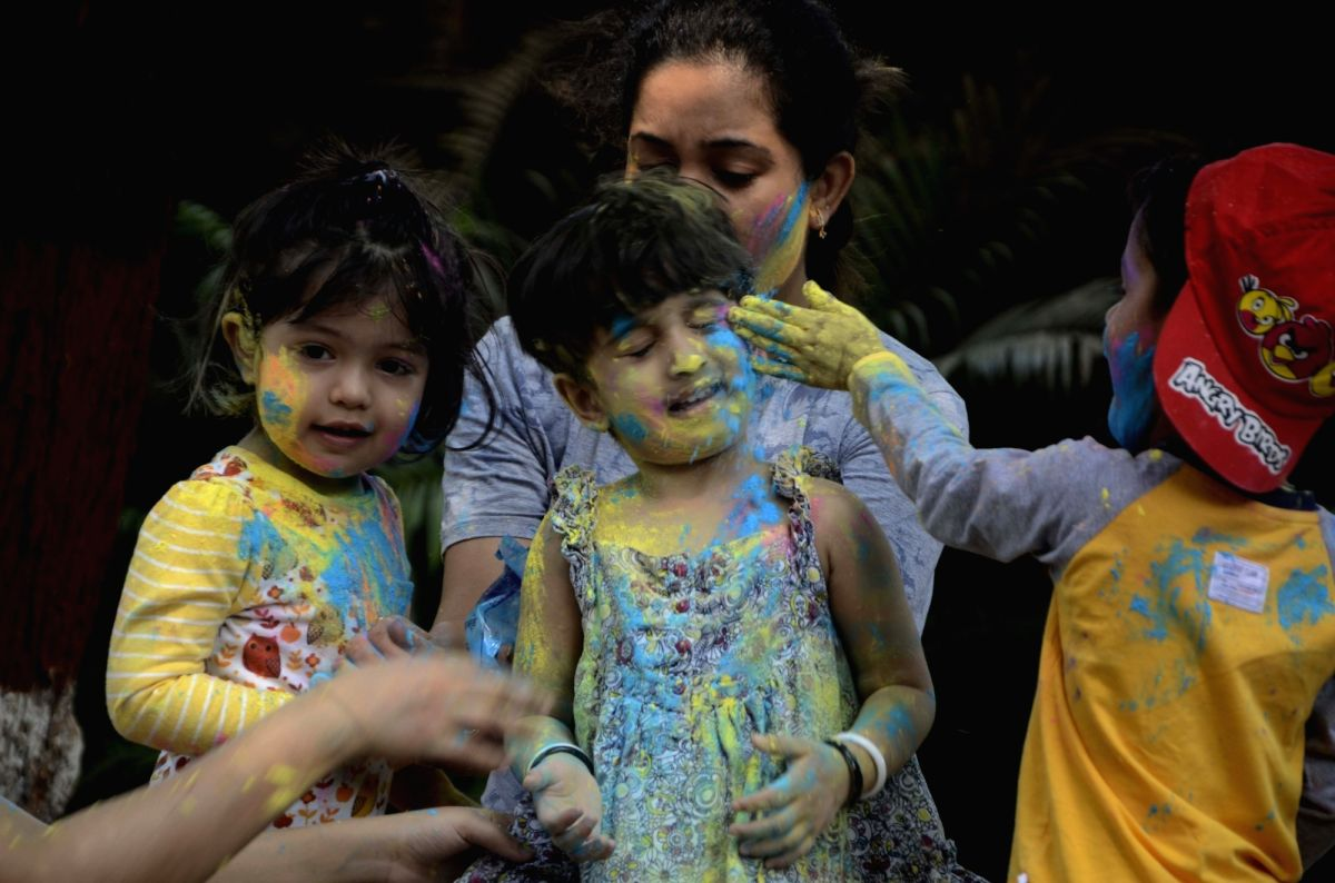 Children celebrate Holi in Mumbai.