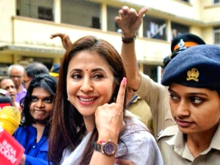 Congress candidate for Mumbai North Lok Sabha seat, Urmila Matondkar shows her forefinger marked with indelible ink after casting vote during the fourth phase of 2019 Lok Sabha elections in Mumbai