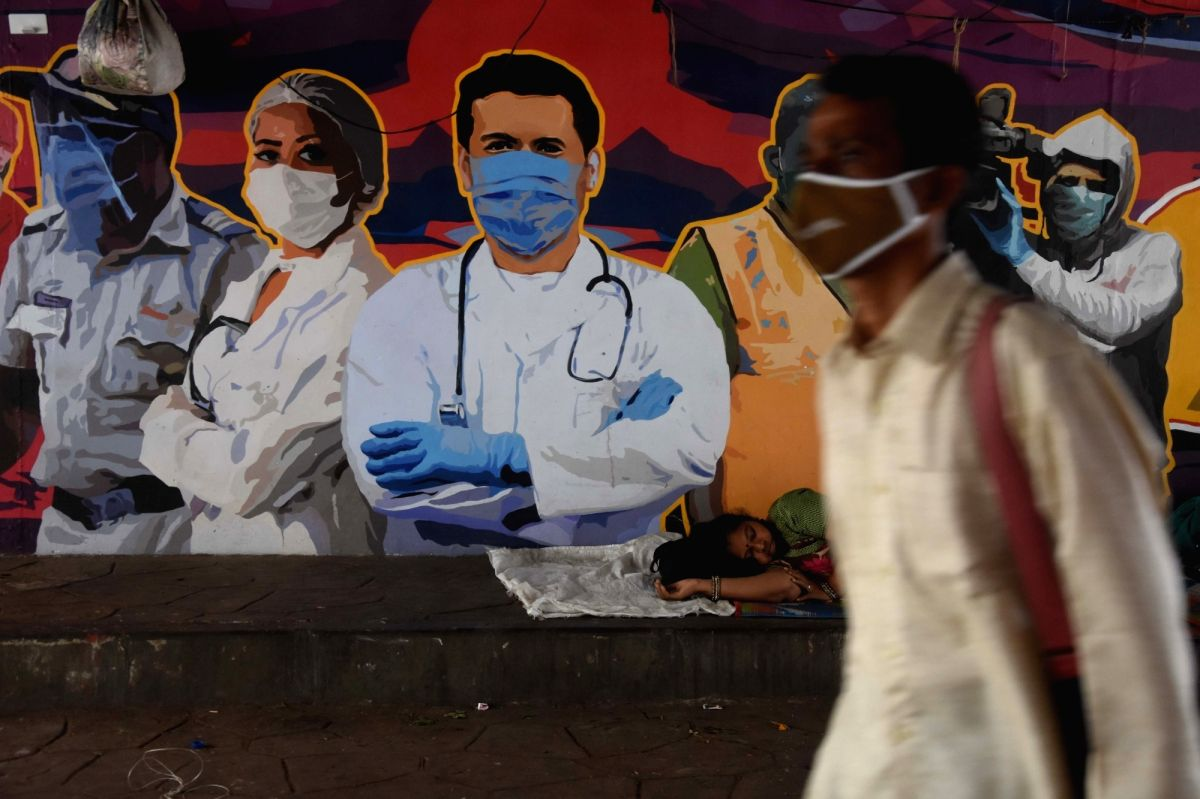 Mumbai: Coronavirus spread all over Mumbai they are state government control very heavy because of vaccine shortage but this wall painting on warriors fight to try to control the Coronavirus on seen they are people wearing masks to cover the face at