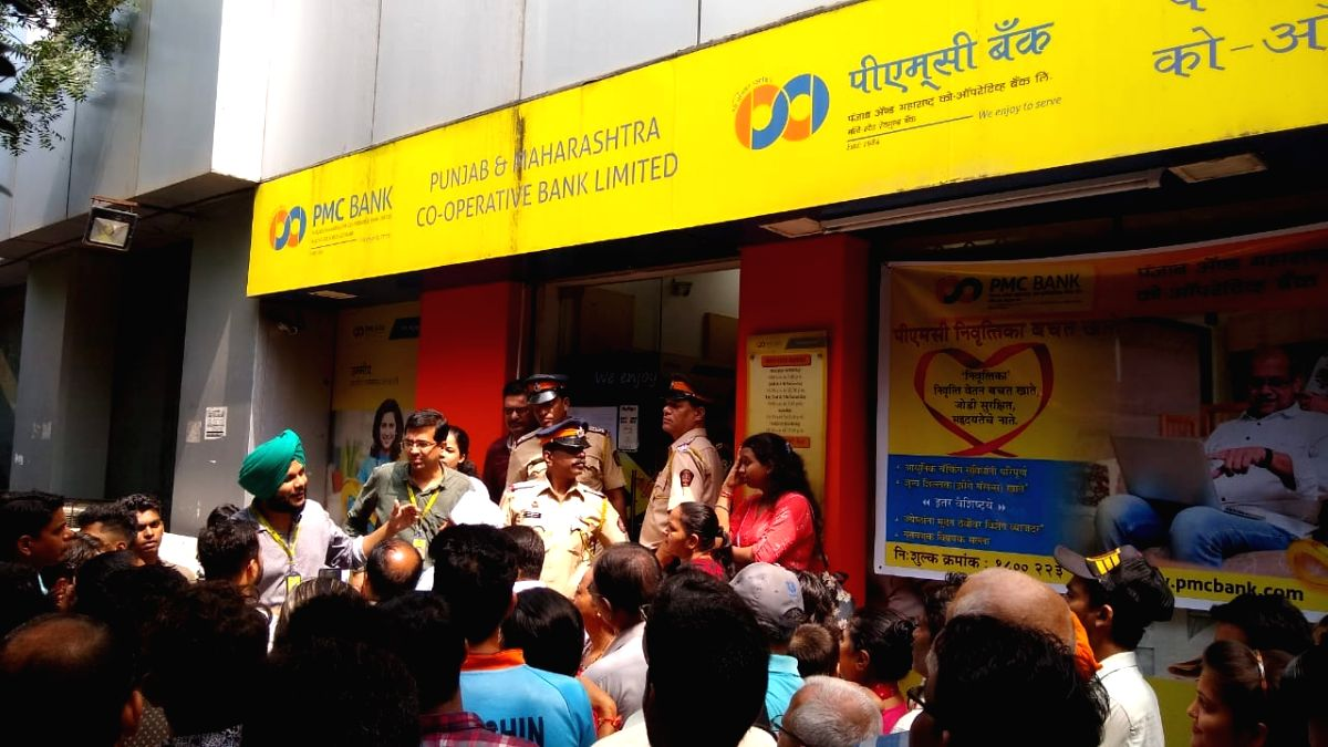Mumbai: Depositors and investors gather outside Bhandup Branch of the Punjab & Maharashtra Cooperative (PMC) Bank after the Reserve Bank of India barred the bank from carrying out a majority of its routine business transactions for a six-month period