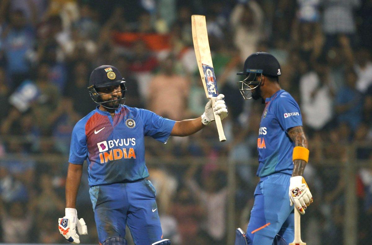 Mumbai: India's Rohit Sharma celebrates his half century with teammate Lokesh Rahul during the third T20I match between India and West Indies at Wankhede Stadium in Mumbai on Dec 11, 2019. (Photo: Surjeet Yadav/IANS)