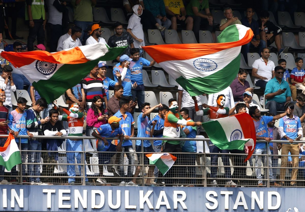 Mumbai: Indian fans cheer for their team during the first ODI between India and Australia at the Wankhede Stadium in Mumbai on Jan 14, 2020. (Photo: Surjeet Yadav/IANS)