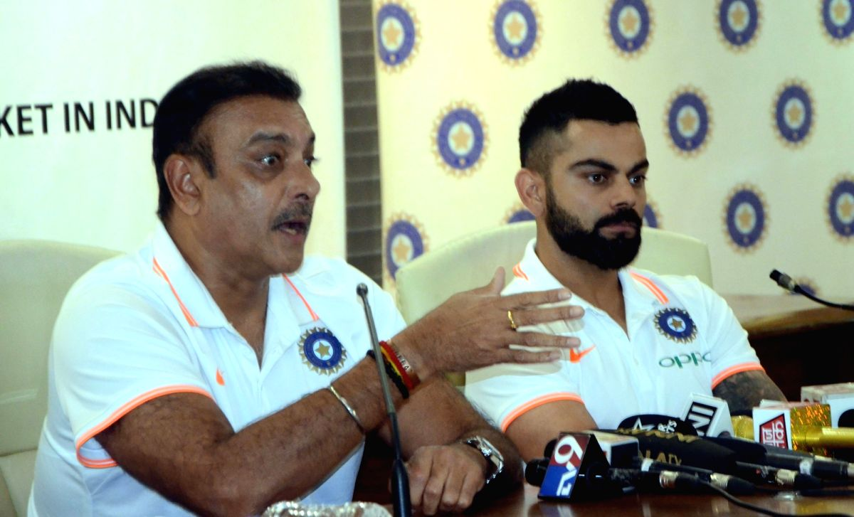 Mumbai: Indian head coach Ravi Shastri accompanied by captain Virat Kohli, addresses a press conference ahead of the team's departure for the tour of Australia; in Mumbai on Nov 15, 2018. India prepares for the challenging tour to Australia, that inc