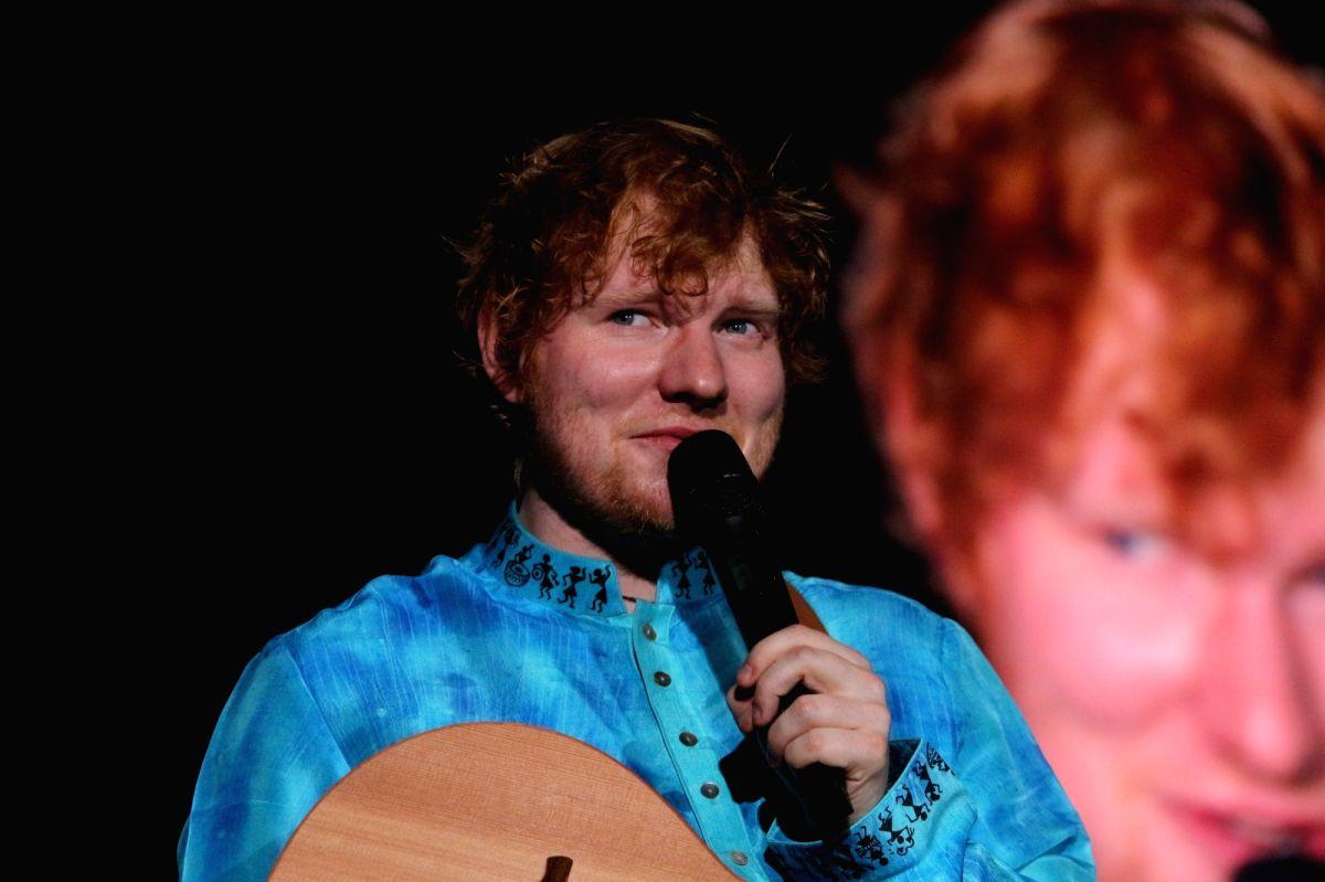 """Mumbai: International Singer Ed Sheeran performs during his concert """"Divide Tour"""" in Mumbai on Nov 19, 2017. (Photo:IANS)"""