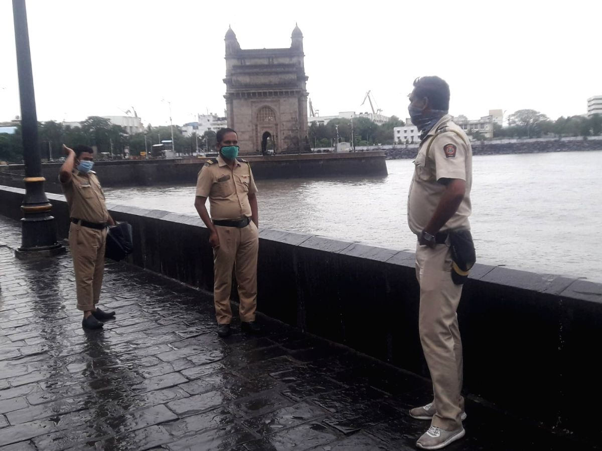 Mumbai: June 3 Mumbai Police man the promenade at Gateway of India to prevent people stepping near the Arabian Sea water in view of Cyclone NISARGA which will hit Maha coast at Raigad, @40 kms south of Mumbai, today.