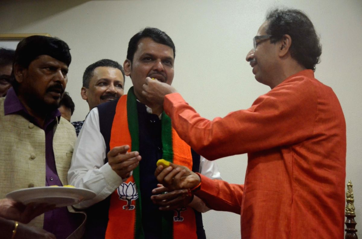 Mumbai: Maharashtra Chief Minister Devendra Fadnavis, Union Minister Ramdas Athawale and Shiv Sena chief Uddhav Thackeray celebrate as the BJP-led NDA is set to retain power for another five years after making a sweep of the 2019 Lok Sabha battle and
