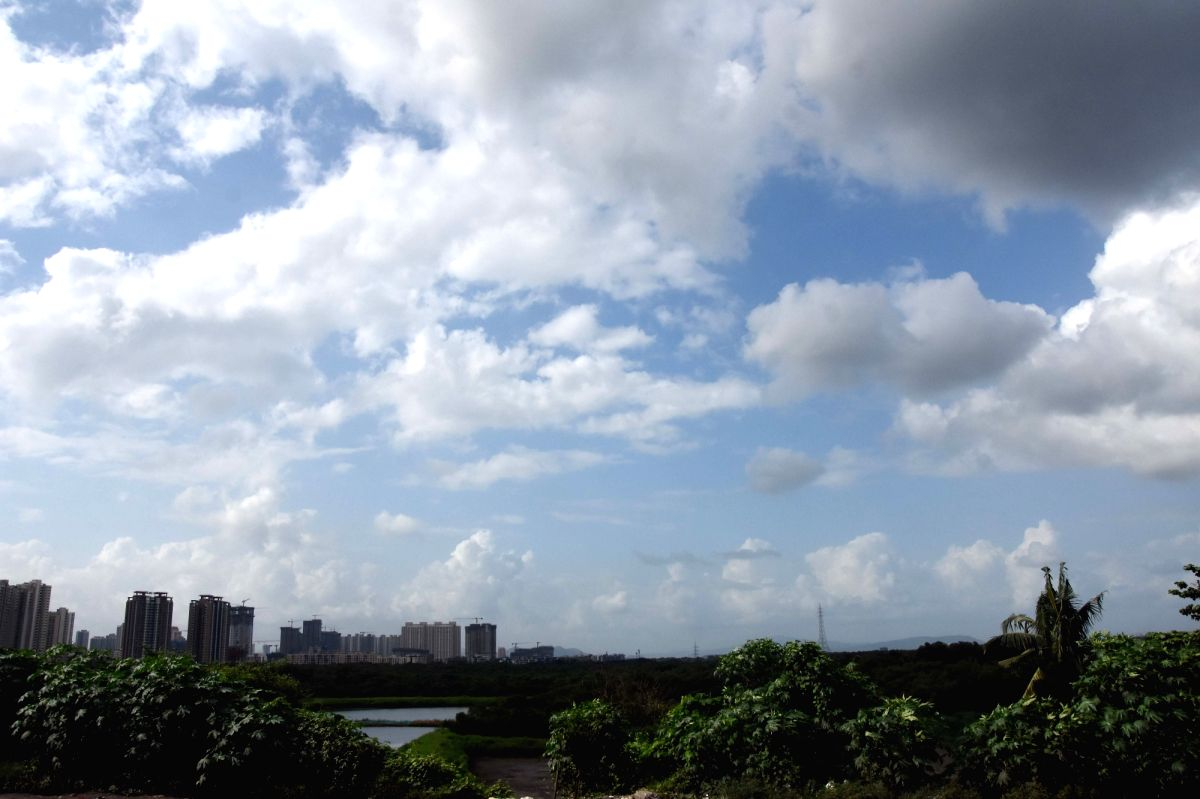 Mumbai: Monsoon clouds cover the sky to see nature's beauty at Thane in Mumbai on Saturday, August 28, 2021. (Photo : Sandeep Mahankal/ IANS)