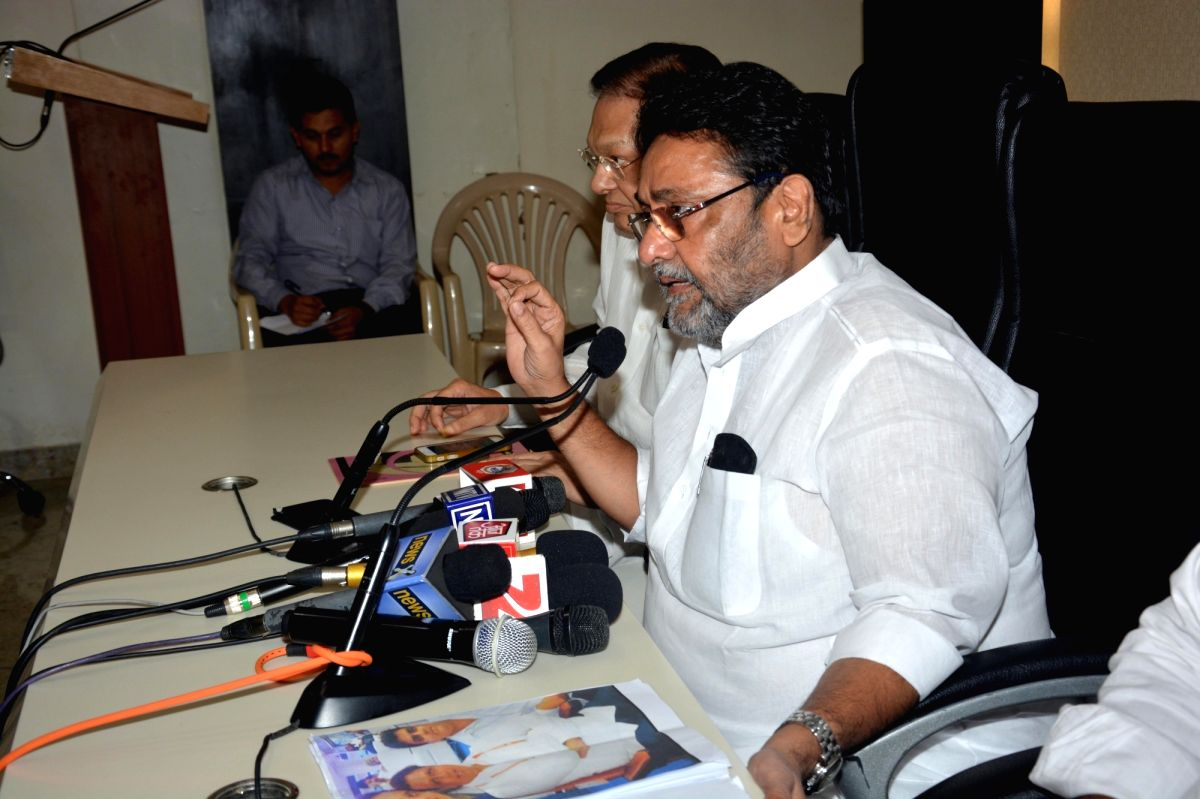 Mumbai: NCP spokesperson Nawab Malik addresses a press conference in Mumbai, on Oct 20, 2016.