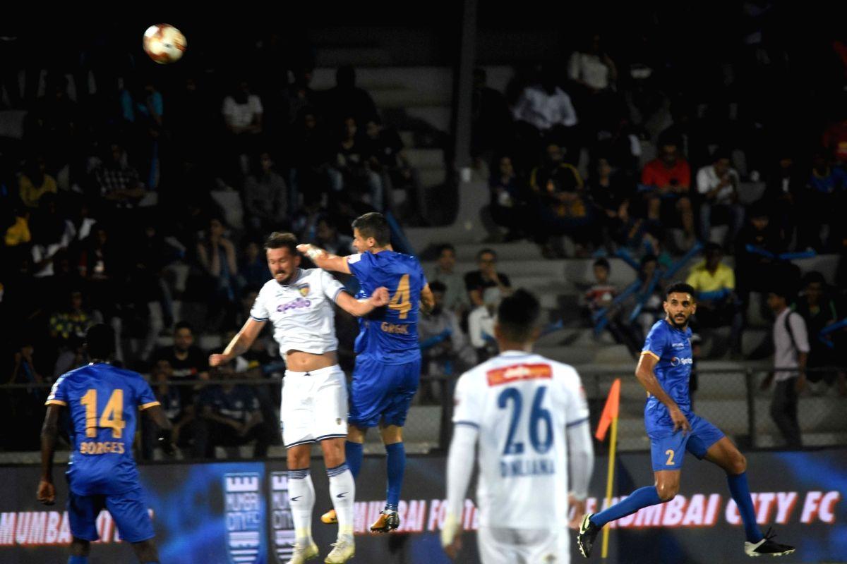 Mumbai: Players in action during an Indian Super League (ISL) match between Chennaiyin FC and Mumbai City FC in Mumbai on Feb 21, 2020.