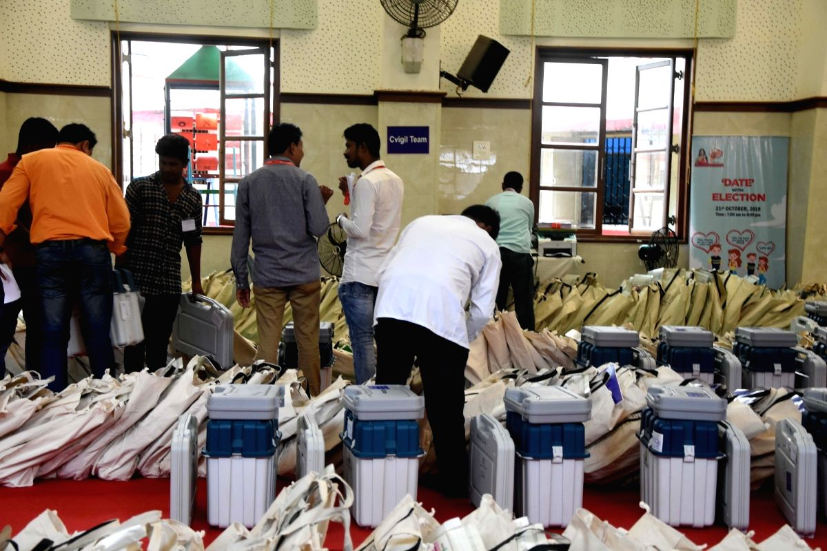 Mumbai: Polling officials checking the Electronic Voting Machine (EVMs) and other necessary inputs required for the Maharashtra Assembly Election at a distributions centre in Mumbai on Oct 20, 2019. (Photo: IANS/PIB)