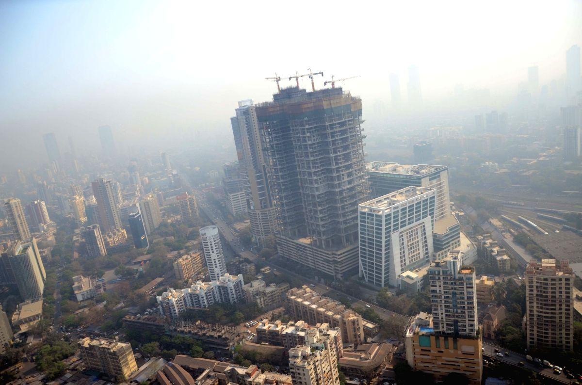 Mumbai: Under construction skyscrapers in Mumbai on Feb 22, 2018. (Photo: Sandip Mahankal/IANS)