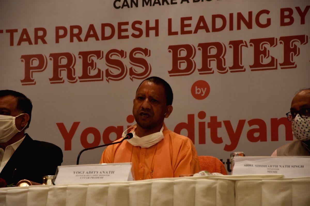 Mumbai: Uttar Pradesh Chief Minister Yogi Adityanath addresses a press briefing in Mumbai on Dec 2, 2020. Yogi Adityanath rang the bell at the Bombay Stock Exchange (BSE) marking the listing of bonds of the Lucknow Municipal Corporation (LMC), here o