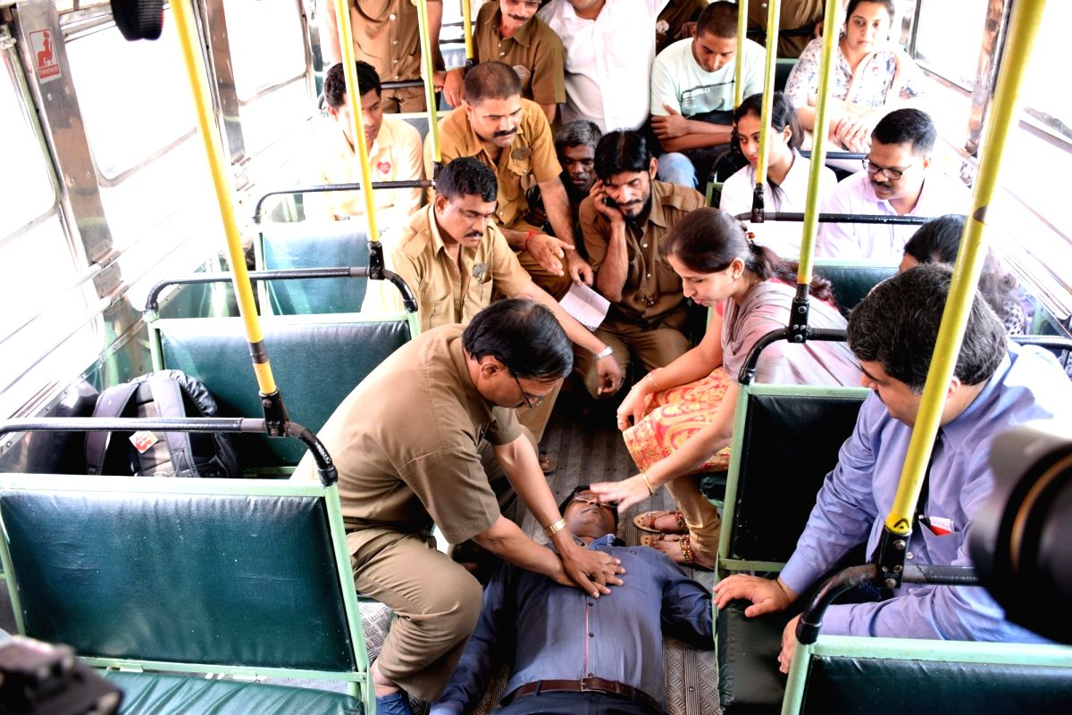 Mumbai: Wockhardt Hospital employes demonstrate life saving technique of Hands Only Cardio Pulmonary Resuscitation (CPR) to conductors and drivers during a training camp in Mumbai on Sept 28, 2016.