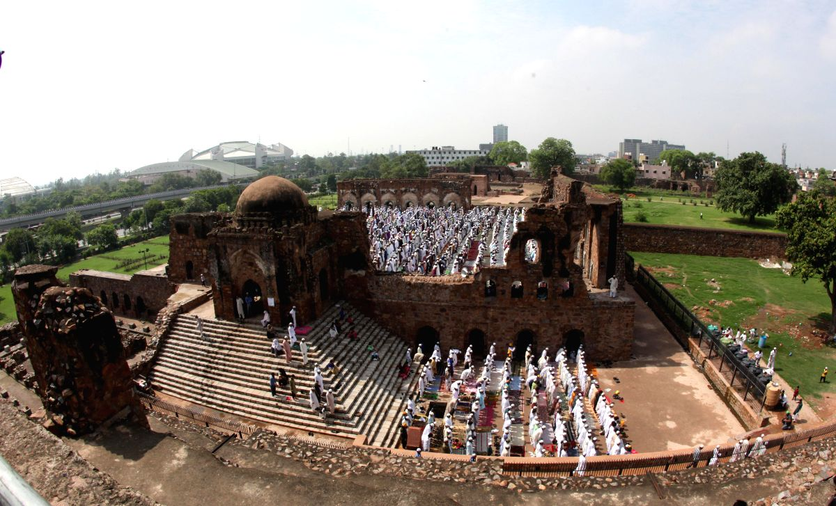Muslims offer prayers on occassion of Eid-ul-Fitr at the Feroz Shah Kotla Fort mosque in Delhi