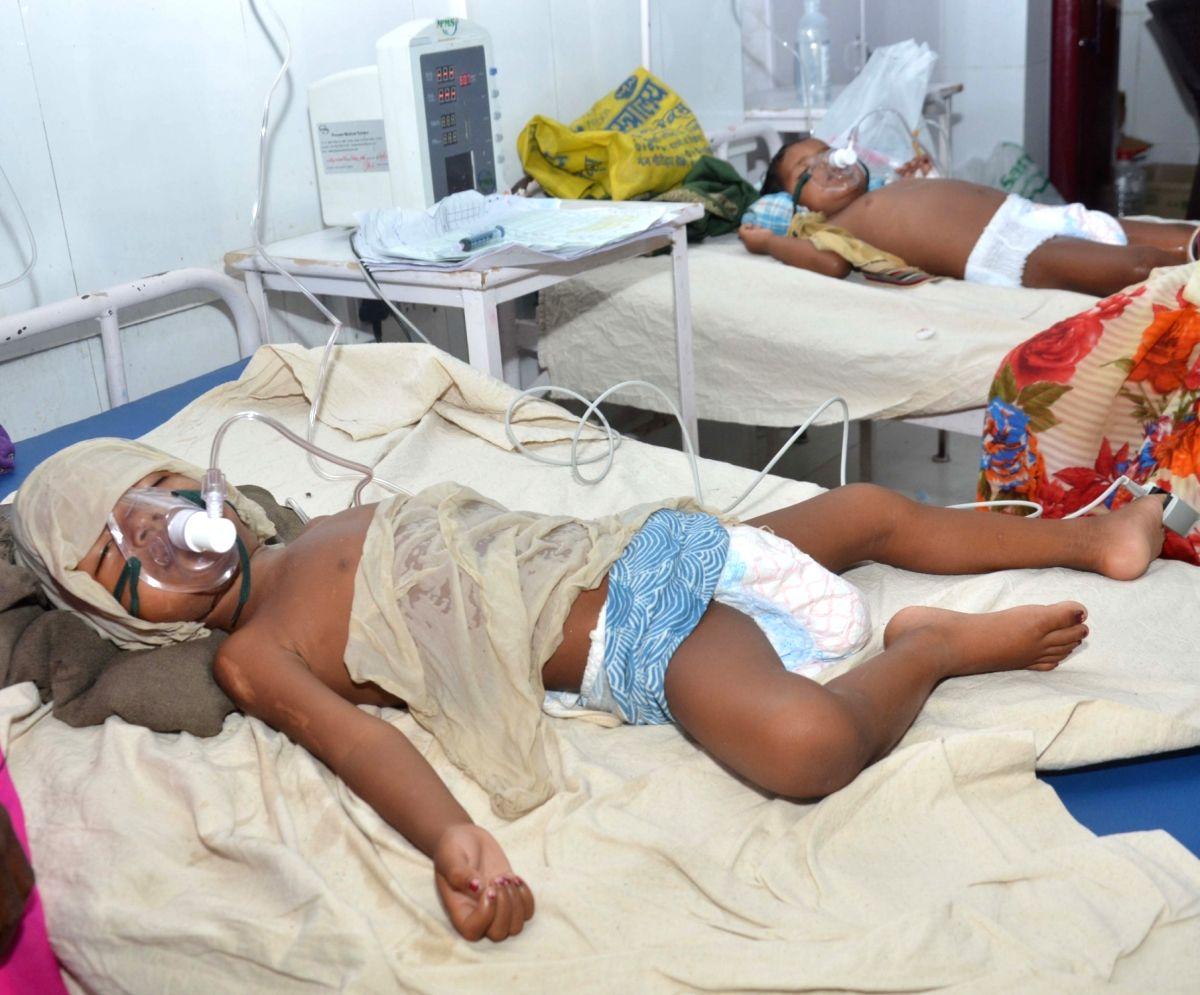 Muzaffarpur: Children with Acute Encephalitis Syndrome (AES) symptoms being treated at hospital in Muzaffarpur, Bihar on June 19, 2019.