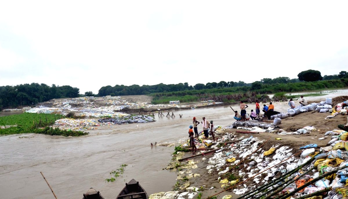 Muzaffarpur: Heavy rains leave a dam on the sub-section of Bagmati river, damaged inundating the Benipur Janarh village in Bihar's Muzaffarpur district, on July 9, 2019.