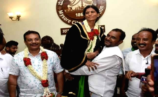 Mysuru Mayor was lifted by her elated husband after elections.
