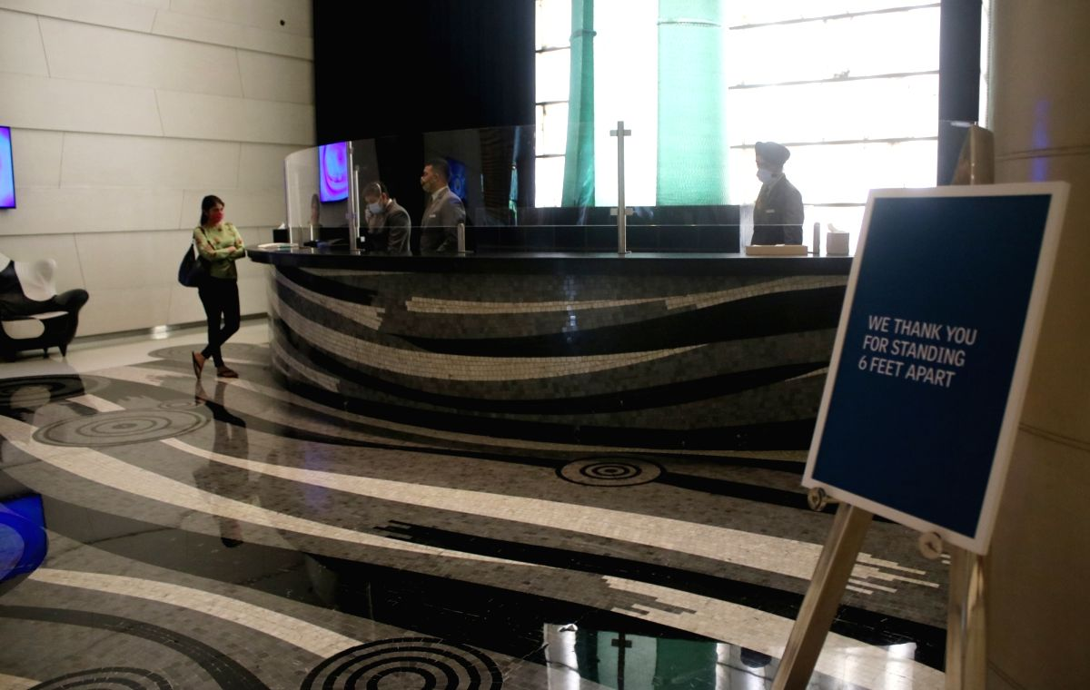 """New Delhi: A board that reads """"We Thank You For Standing 6 Feet Apart"""" installed at the reception to remind people of social distancing at the Le Meridien hotel as it gears up to reopen and resume services amid the ongoing pandemic, in New Delhi on A"""