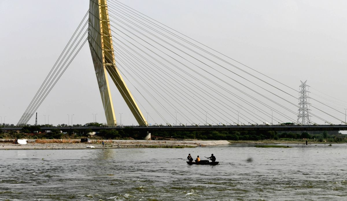 New Delhi: A boat sails on Yamuna river during the nationwide lockdown in the wake of novel coronavirus (COVID 19) pandemic, in New Delhi on April 14, 2020.