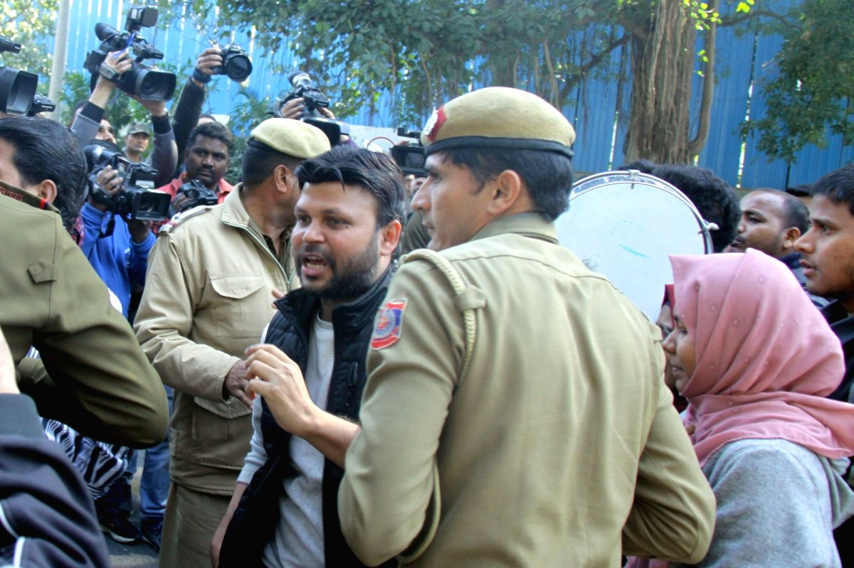 New Delhi: A group of people, including students of Jamia Millia Islamia stage a demonstration near the Tamil Nadu House over the alleged lathicharge by the Chennai police on anti-CAA demonstrators being detained by police, in New Delhi on Feb 15, 20