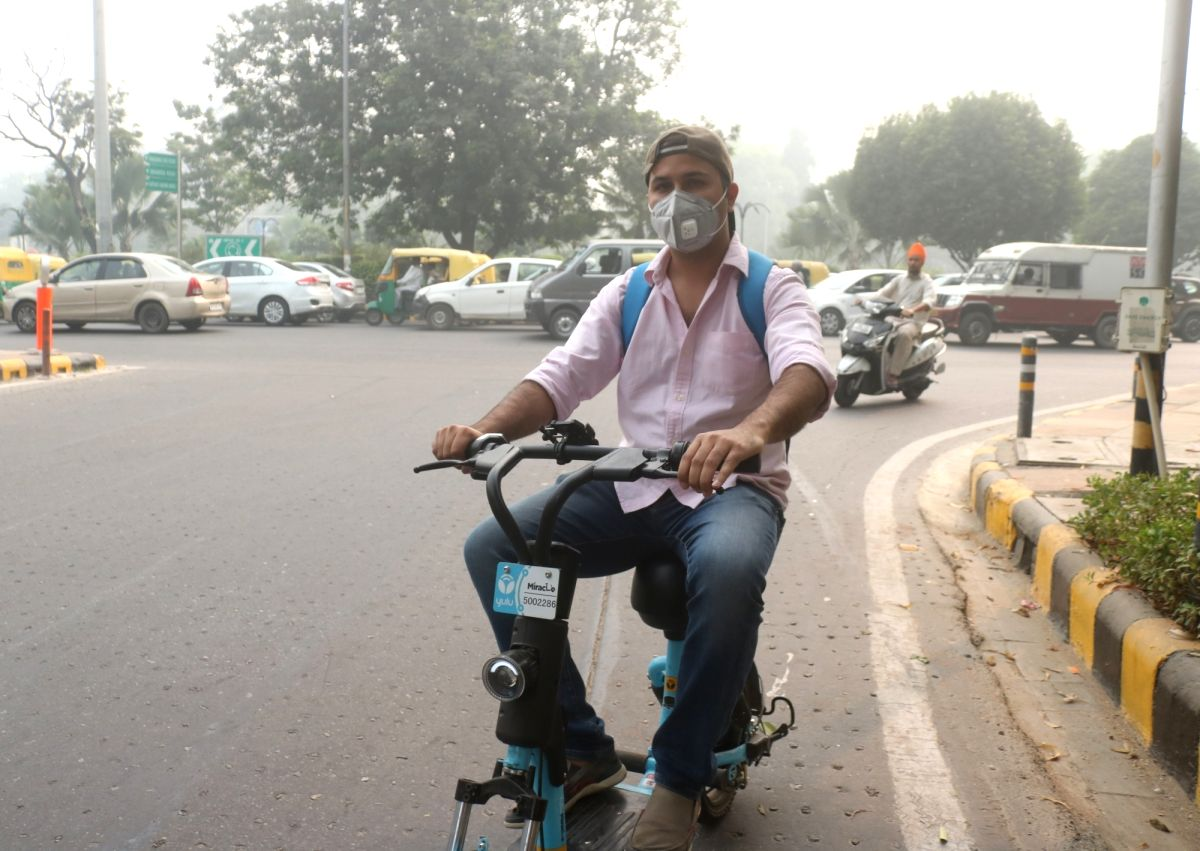 New Delhi: A man wears a mask as a precautionary measure against air pollution, in New Delhi on Oct 30, 2019. There has been a sharp improvement in Delhi's Air Quality Index (AQI) on Wednesday morning even as smog covered the city skyline. The AQI re
