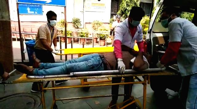 New Delhi: A person who sustained injuries during violent clashes between pro- and anti-CAA protesters in northeast Delhi, being brought at GTB Hospital for medical treatment, on Feb 25, 2020. More than 15 people have sustained bullet injuries. in th