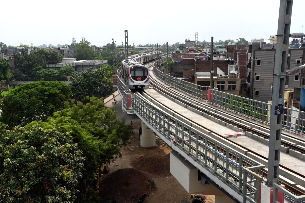 New Delhi : A pink line metro train run on a track after Delhi metro remaining portion of the pink line corridor was inaugurated in New Delhi on Friday, August 06, 2021. (Photo: Wasim Sarvar/IANS)