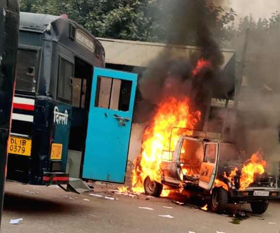 New Delhi: A vehicle set ablaze during a scuffle that broke out between the Delhi Police and lawyers, leaving an advocate injured with a bullet injury to his chest, at the Tis Hazari court in New Delhi on Nov 2, 2019. According to sources, the scuffl