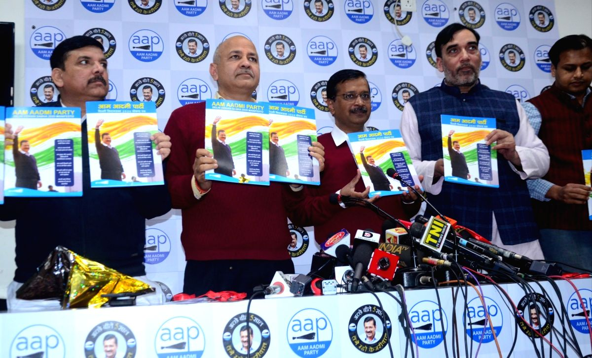 New Delhi: Aam Aadmi Party (AAP) National Convener Arvind Kejriwal, Cabinet Ministers Manish Sisodia and Gopal Rai and party leader Sanjay Singh release the party's election manifesto for the February 8 Delhi Assembly polls, at the party's headquarte