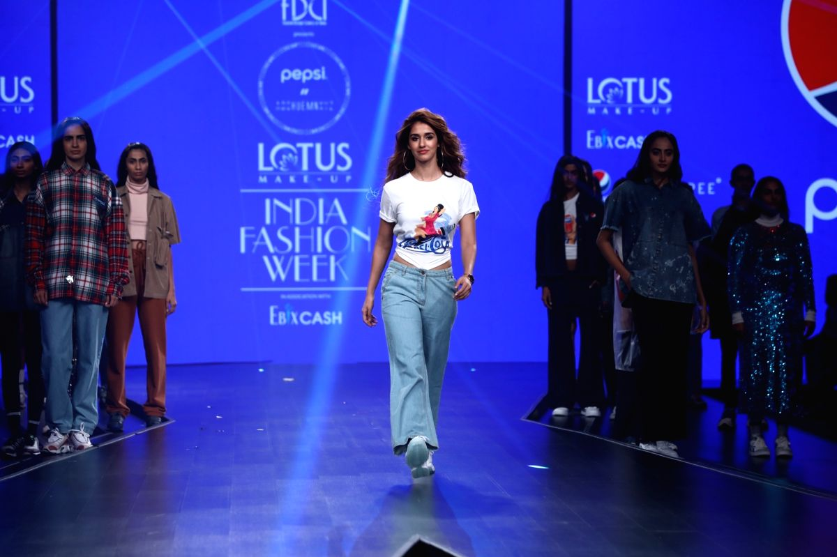 Actress Disha Patani walks the ramp showcasing collection from Pepsi's ready-to-wear label HUEMN on the first day of Lotus Make-up India Fashion Week