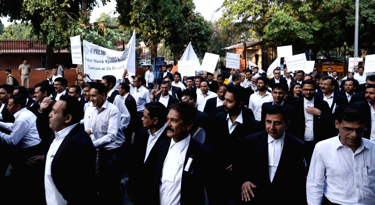 New Delhi: Advocates of Supreme Court under the banner of Supreme Court Bar Association, participate in a march to protest against brutal attack and firing on lawyers at Tis Hazari Court on Saturday; in New Delhi on Nov 4, 2019.