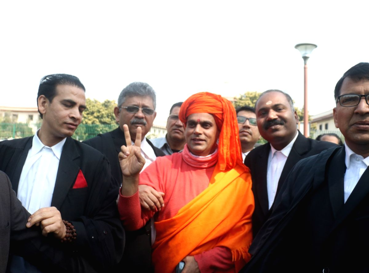 New Delhi: All India Hindu Mahasabha leader Swami Chakrapani Maharaj talks to media persons at Supreme Court in New Delhi on March 7, 2019. The Supreme Court on Friday ordered mediation to settle the Ram Janmabhoomi-Babri Masjid Ayodhya title dispute