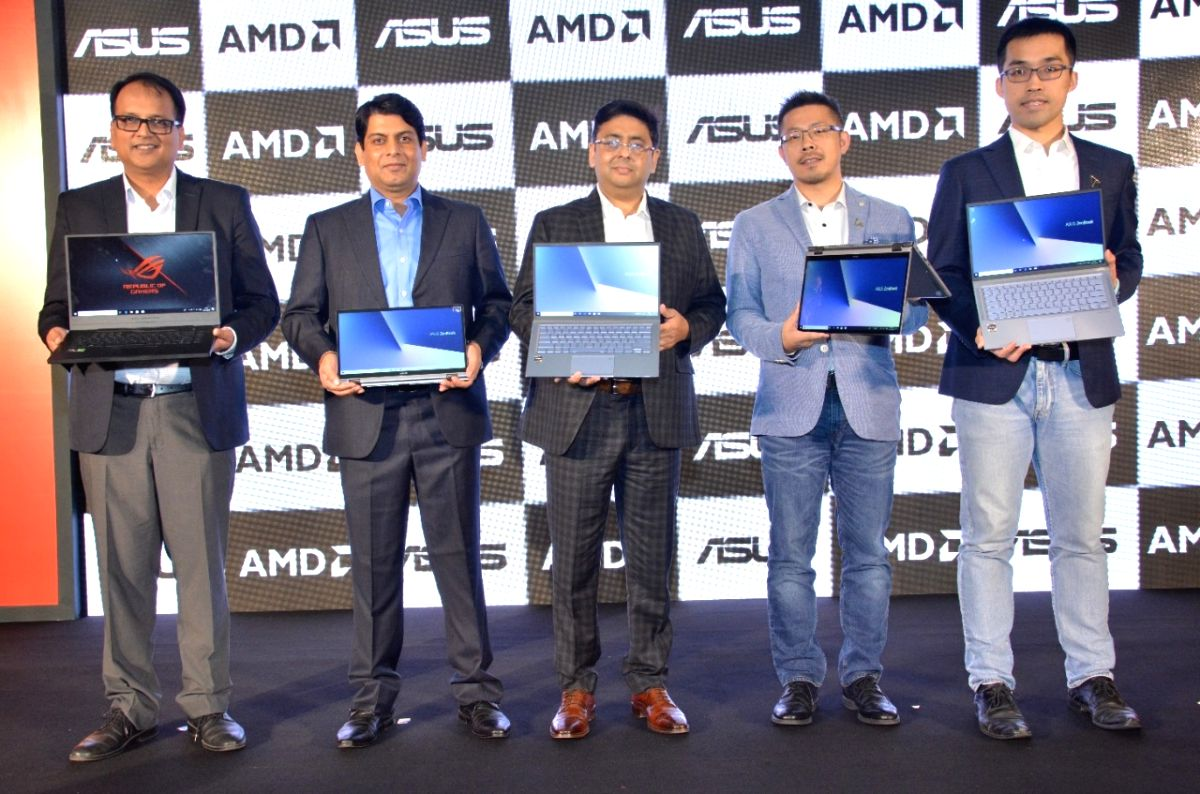 New Delhi: ASUS India Business Head (PC, Gaming And Commercial Products) Arnold Su and other officials at the launch of first AMD powered ZenBook and ZenBook Flip, in New Delhi on Nov 12, 2019.