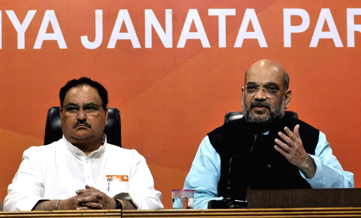 New Delhi: BJP chief Amit Shah addresses a press conference in New Delhi on June 19, 2017. Also seen party leader and Union Minister JP Nadda.